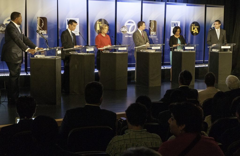 The candidates and emcee during the ABC-TV mayoral debate in the Student Union theater on the CSULA campus Monday 18 February 2013.